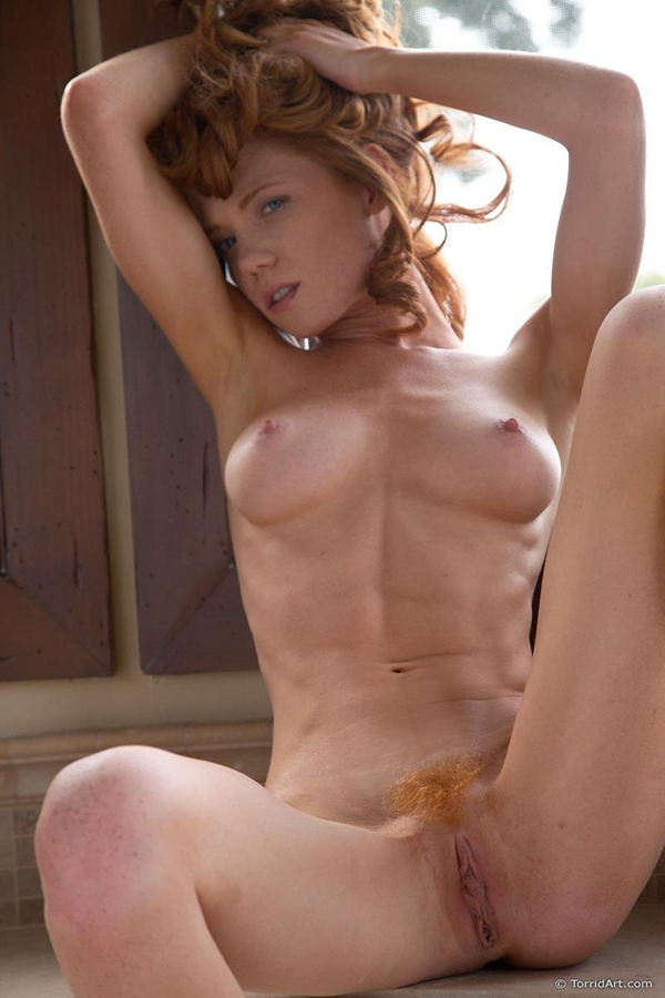 A muscular redhaired sexy girl 2